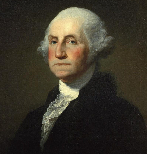 Es ist ein historisches Ölgemälde von George Washington, der zum Betrachter schaut. Es ist eines der bekanntesten Motive über den US-Präsidenten. Er hat eine weiße Perücke auf und ein Rüschenhemd an.