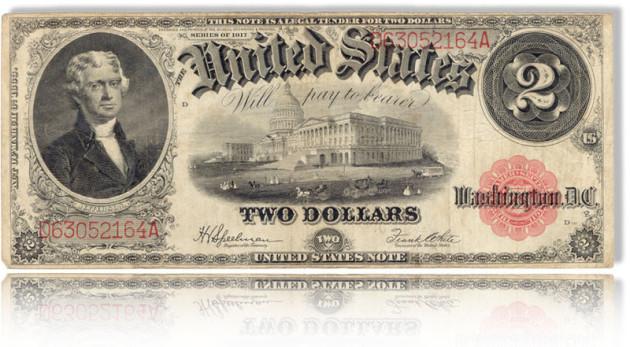 """Man sieht einen historischen Zwei-Dollarschein. Man kann """"United States"""" lesen und """"Twoi Dollars"""". Die Illsutration hat einen Spiele unter dem Schein."""